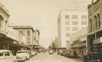 Downtown street scene, Victoria, TX:  Main Street looking north, ca 1940s.